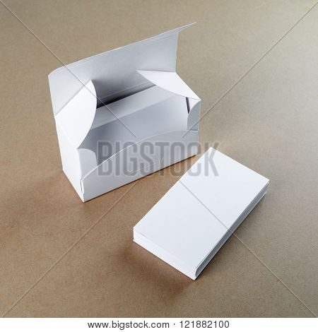 A box with blank business cards and a stack of business cards. For design presentations and portfolios.