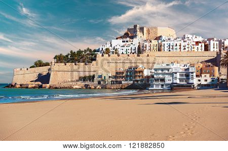 Peniscola castle view from the beach. Costa del Azahar province of Castellon Valencian Community. It is a popular tourist destination in Spain
