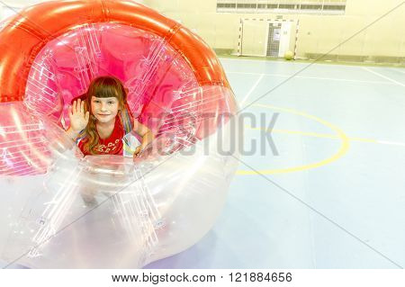 having fun playing bumper ball indoors