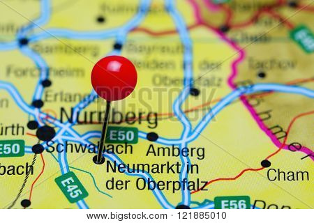 Photo of pinned Neumarkt in der Oberpfalz on a map of Germany. May be used as illustration for traveling theme.