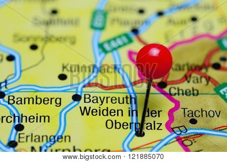 Photo of pinned Weiden in der Oberpfalz on a map of Germany. May be used as illustration for traveling theme.