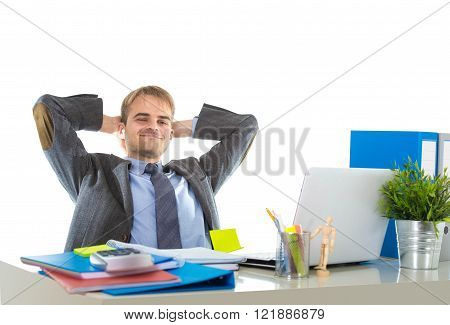 corporate portrait of young attractive businessman leaning back on his chair relaxed and smiling happy and satisfied in business success concept isolated on white background