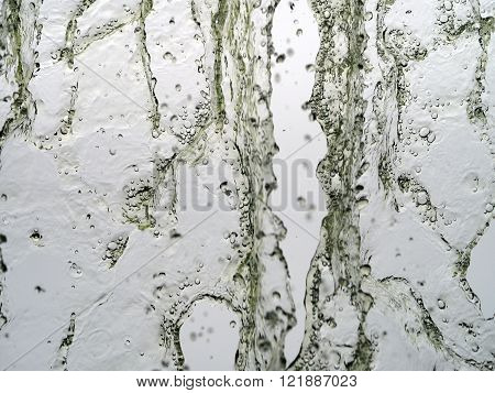 Flowing water in a cascade with water drops