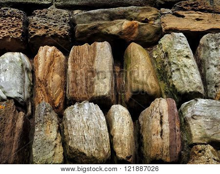 Stone wall with worn and weathered rocks