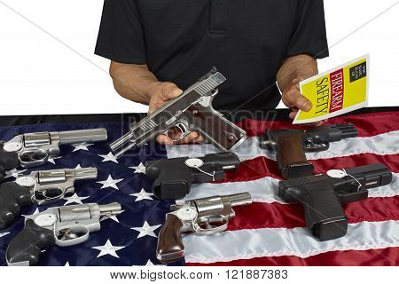 Man with guns for sale with safety brochure on USA America Flag
