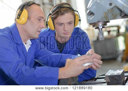 workers with earmuffs