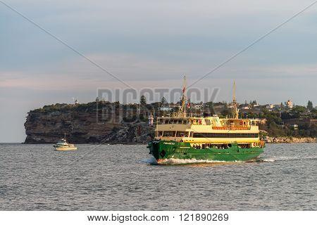 Sydney Australia - November 10 2015: Transport Sydney Ferry boat heading to Sydney Cirqular Quay with passengers onboard on a warm sunny evening.