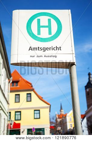 german bus stop sign on Amtsgericht - sign means - district court - only get out