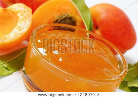 detail of fresh apricots and bowl of apricot jam