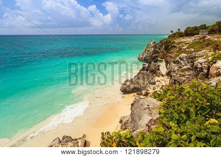 Idyllic Caribbean beach at the Mayan ruins temple of Tulum, Mexico