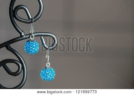 A Pair Of Handmade Earrings From Beads Of Turquoise Color Close Up