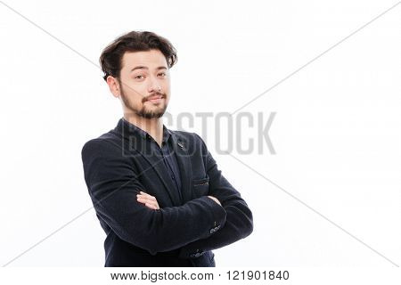 Happy businessman standing with arms folded isolated on a white background
