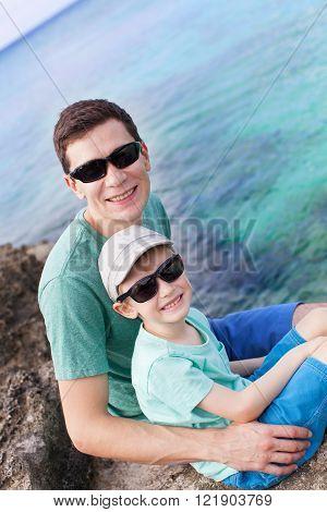 family of two enjoying rocky beach at grand cayman cayman islands caribbean