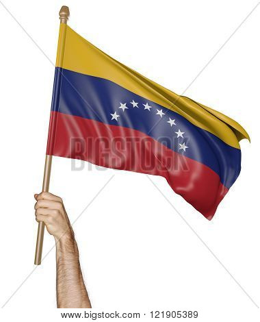 Hand proudly waving the national flag of Venezuela