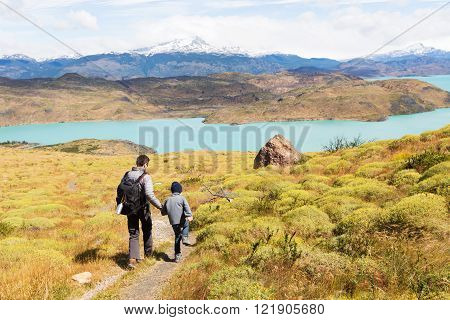 active father and his son having adventure hike at torres del paine national park patagonia chile