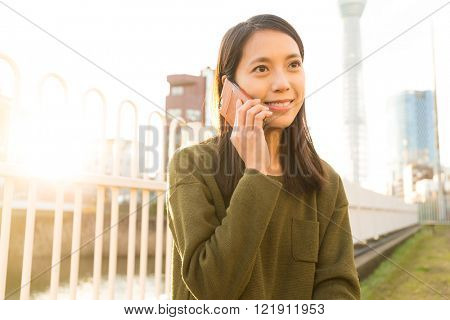 Woman talk to cellphone at Tokyo city
