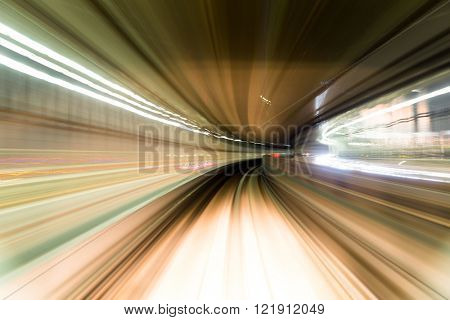 Fast train passing by train station