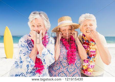 Senior woman doing grimace on the beach