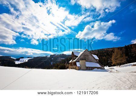 Village in Alps under deep snow Klippitztorl Carinthia Austria