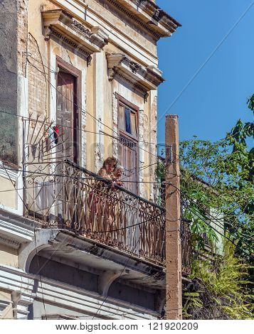 Cienfuegos, Cuba - March 30, 2012: Two Women Looking From Balcony Of Old House