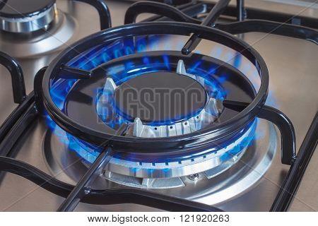 Closeup of burning gas turbo burner of stove