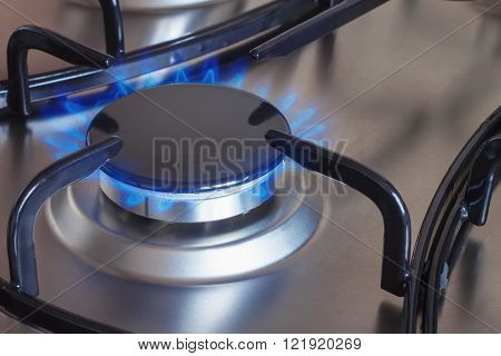 burner with burning gas on the kitchen gas stove