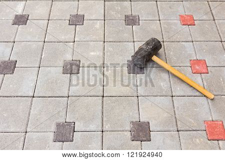 Mason tool for curb stone and brick pavement laying down rubber mallet.