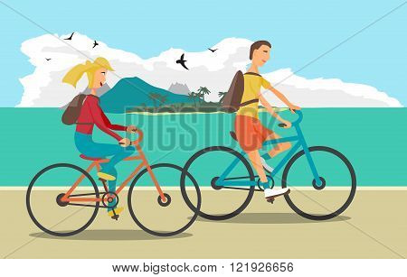 Young woman and man ride the bike on the beach. Healthy leisure