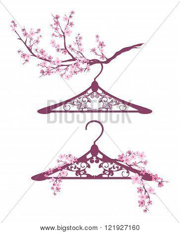 hangers among blooming branches - spring season fashion design vector set