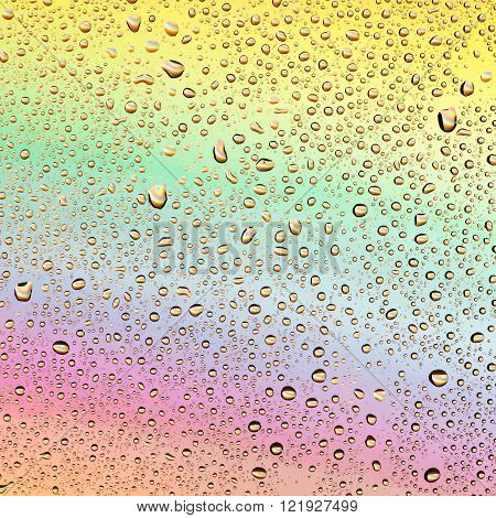 Colored drops on a rainbow background