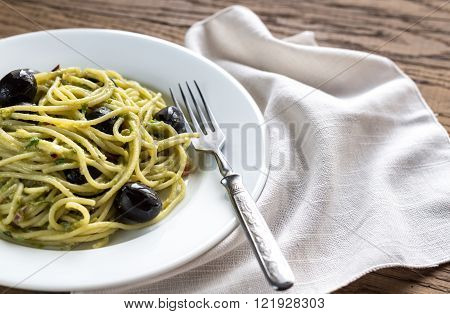 Pasta With Guacamole Sauce And Black Olives