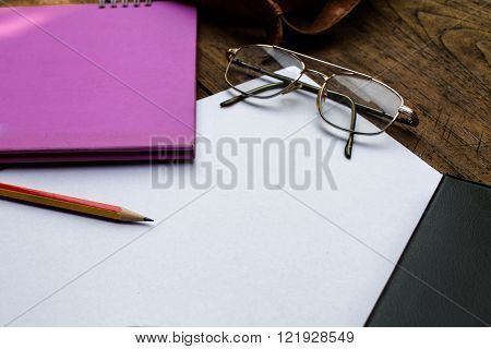 Sketchbook Or Notebook With Pencil On Old Wooden Table
