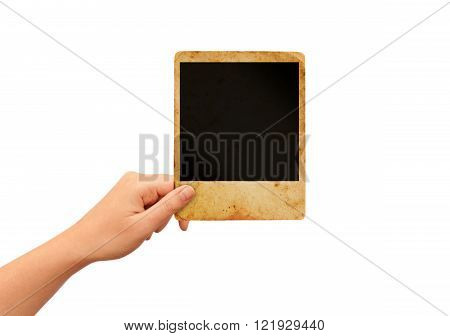 Hand holding blank instant photo card isolated on white background