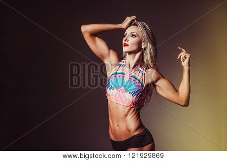Female Fitness Bodybuilder, on a dark background