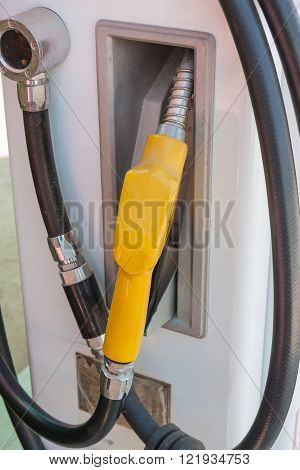 Fuel nozzle at a gas station. Petrol station. Filling station. Petrol. Gasoline