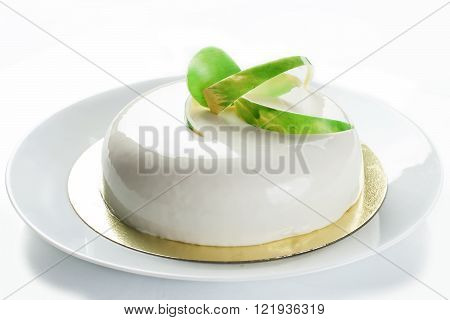 Cake in white glaze. Pastry. Jellies and souffle