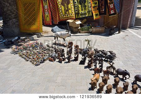 SWAKOPMUND, NAMIBIA - JAN 31, 2016: Hand made souvenirs - african animals shown on the craft market in Swakopmund. Local hand made toys and other african goods very popular between