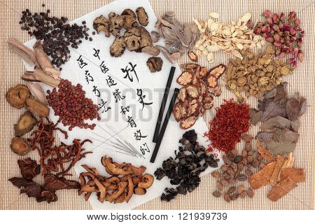 Chinese medicinal herb ingredients, acupuncture needles and moxa sticks  with calligraphy. Translation describes acupuncture chinese medicine as a traditional and effective medical solution.