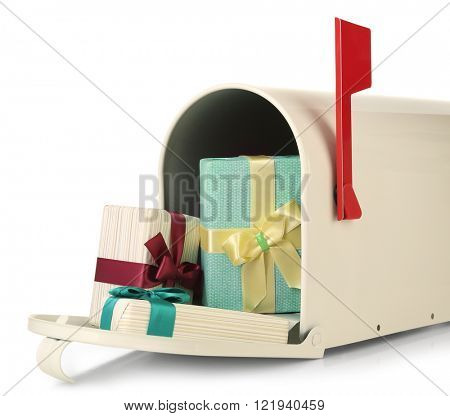 Mailbox with gift boxes isolated on white
