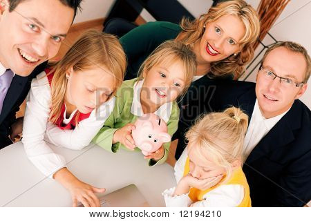 Family with their consultant (assets, money or similar) doing some financial planning - symbolized by a piggy bank in the front