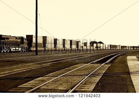 NEEDLES, UNITED STATES - DECEMBER 23: A freight train with a General Electric Dash 9 Locomotive from the BNSF Railway Company and containers standing on a railway on  December 23, 2015 Needles.