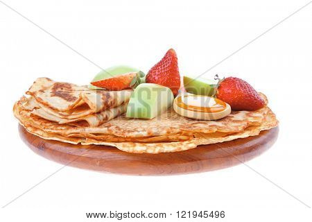 sweet food : big thin pancake with honey strawberries and apple isolated over white background
