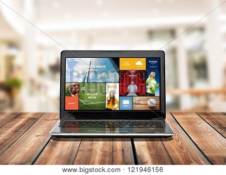 technology, internet, mass media and advertisement concept - laptop computer with web pages on screen