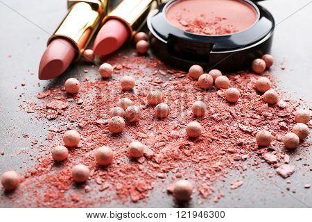 Lipsticks and crumbled blusher for makeup, close-up