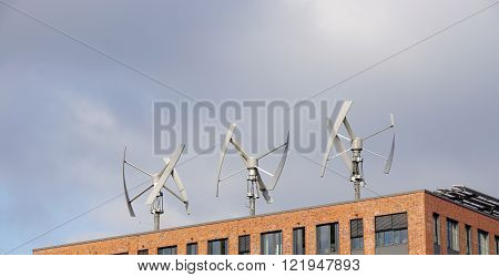 wind power turbines on a rooftop