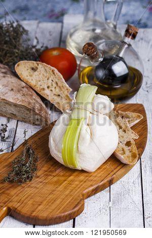 fresh Italian cheese burrata mozzarella with ciabatta ** Note: Shallow depth of field