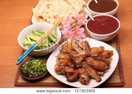 Chinese food:  Beijing duck, spring onion and sauses