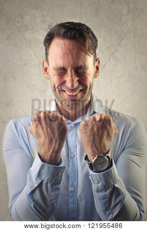 Happy man jubilating