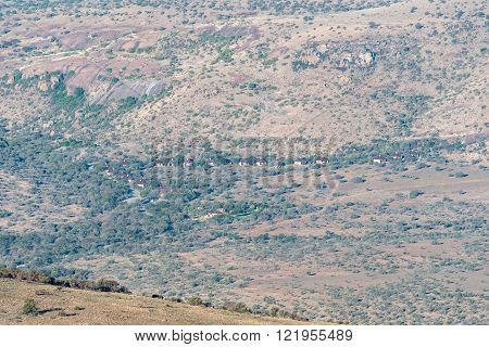 MOUNTAIN ZEBRA NATIONAL PARK, SOUTH AFRICA - FEBRUARY 16, 2016: A view of the offices, chalets and camping sites as seen from the mountain pass on the Kranskop Loop