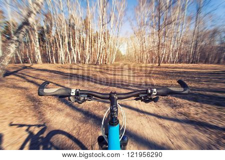 Mountain biking down hill descending fast on bicycle.